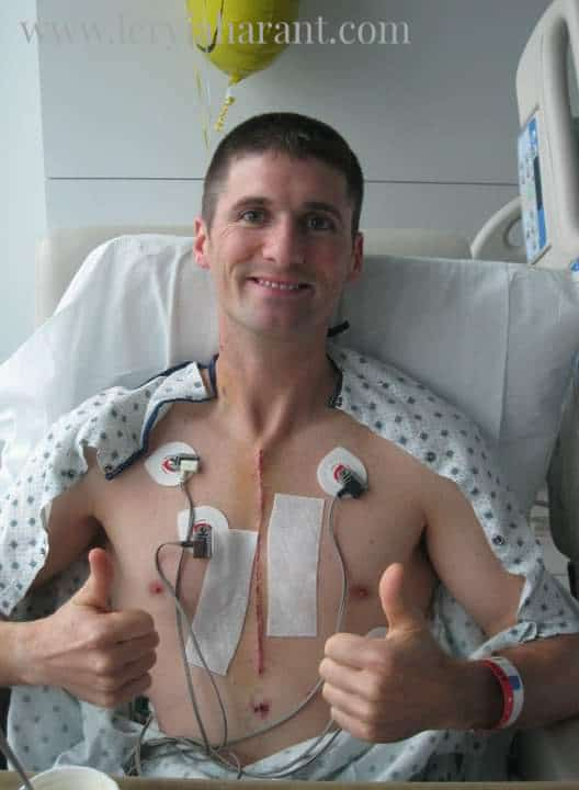 young male open heart surgery survivor with two thumbs up