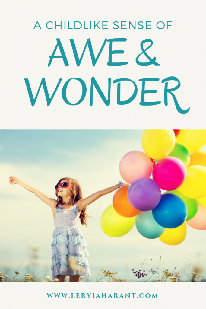 little girl with balloons and an incredible sense of wonder