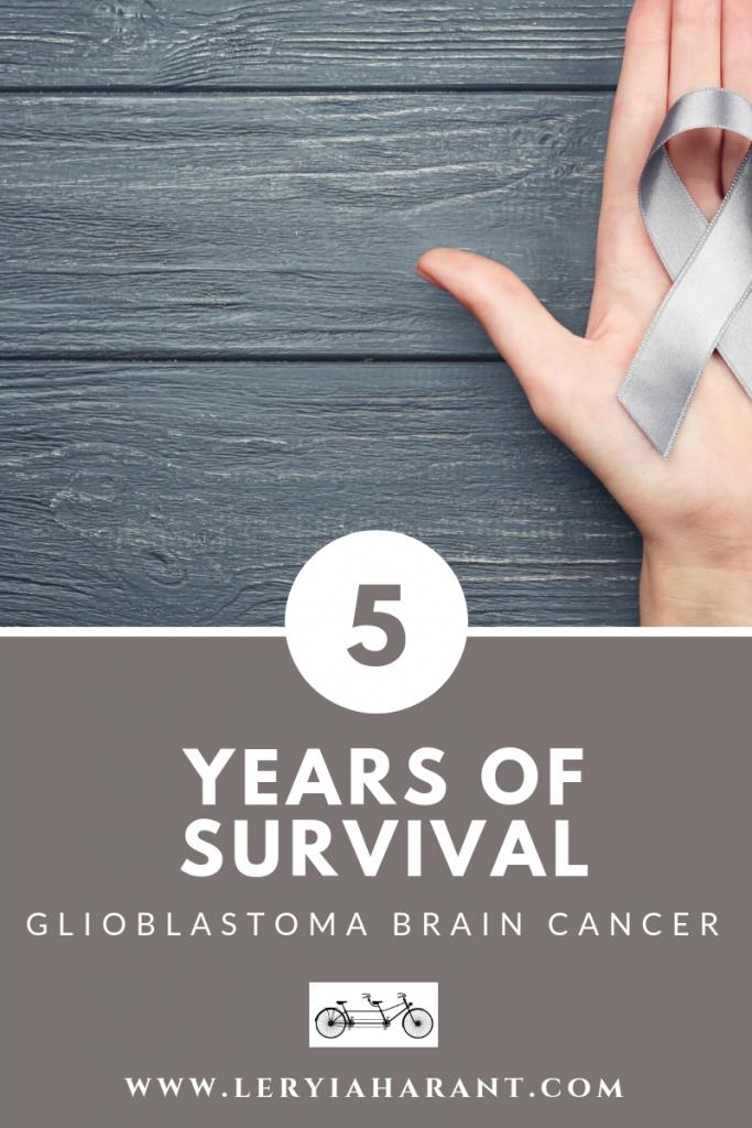 brain cancer survivor gray awareness ribbon on a wooden background