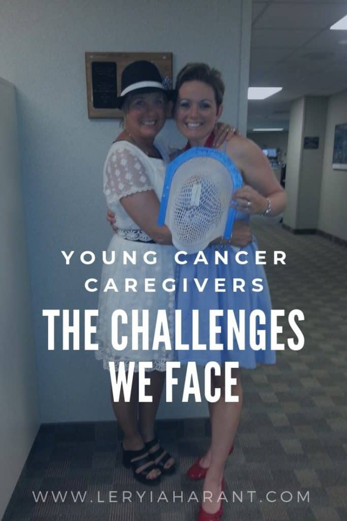 mom and daughter holding a brain cancer radiation mask