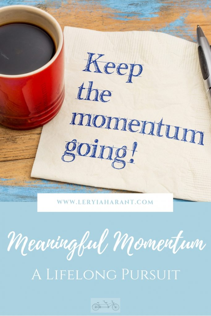 napkin with keep the momentum wording on it with coffee cup