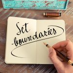 journal with words set boundaries written