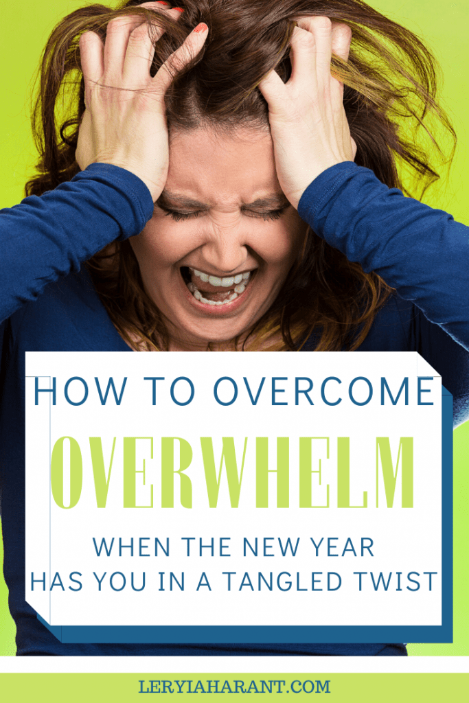 overwhelmed woman screaming with hands on head