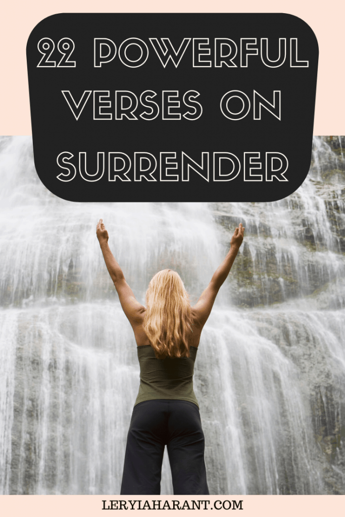 woman in full surrender to god hands outstretched in front of waterfall