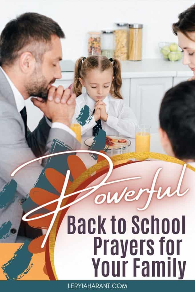 family praying back to school prayer at the dinner table